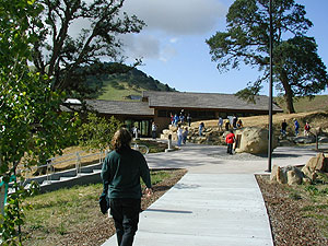 Lady walking down sidewalk at John Muir Interpretive Center