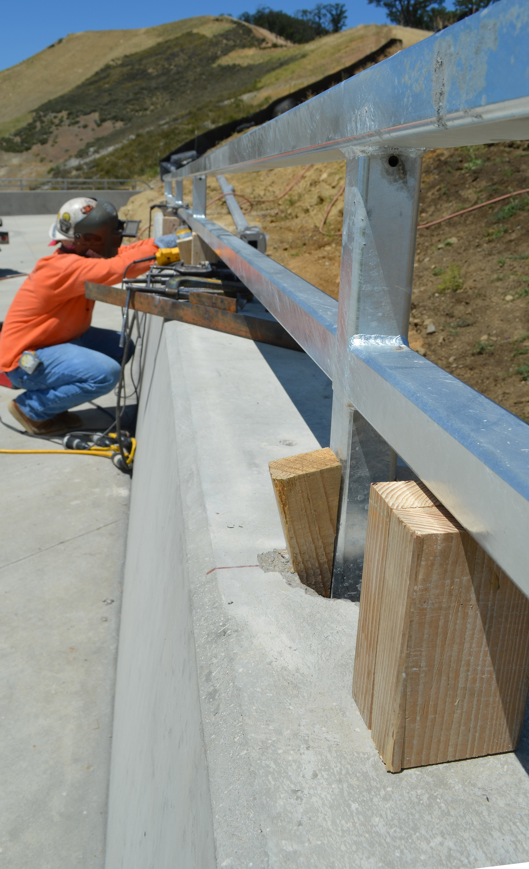 An ironworker smooths the railing
