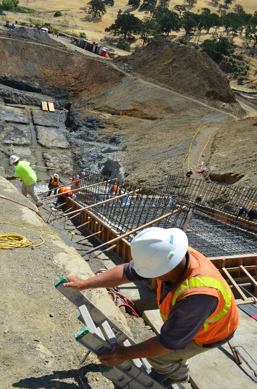 Worker climbs out of the spillway area